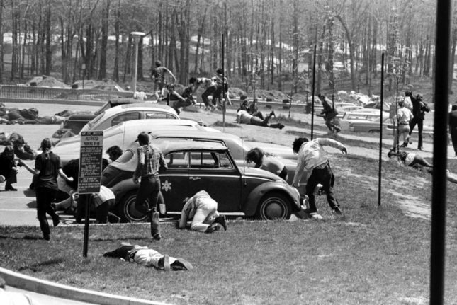 Students dive to the ground as the National Guard fires on faculty and students May 4, 1970, to protest the war in Vietnam. File Photo courtesy of Kent State University Archives
