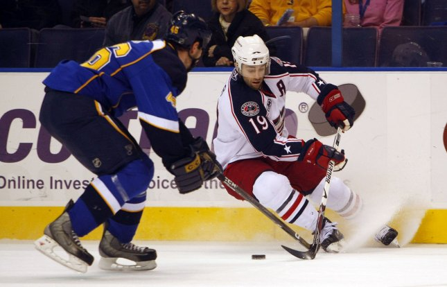 St. Louis Blues Roman Polak (L) uses his stick to stop the progress of Columbus Blue Jackets Michael Peca during the first period at the Scottrade Center in St. Louis on January 3, 2009. (UPI Photo/Bill Greenblatt)