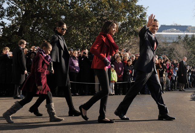 U.S. President Barack Obama, daughter Malia, First Lady Michelle and daughter Sasha (R to L) walk from the White House to Marine One on the South Lawn of the White House on December 24, 2009. The First Family is en route to Hawaii for the Christmas and New Years holidays. UPI/Roger L. Wollenberg
