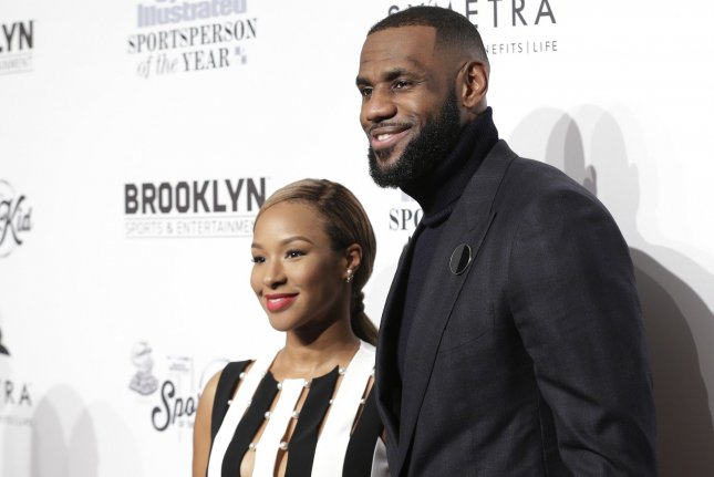 29a36b2e4a91 LeBron James (R) and Savannah Brinson arrive on the red carpet at the  Sports Illustrated Sportsperson of the Year Ceremony 2016 at Barclays  Center in New ...