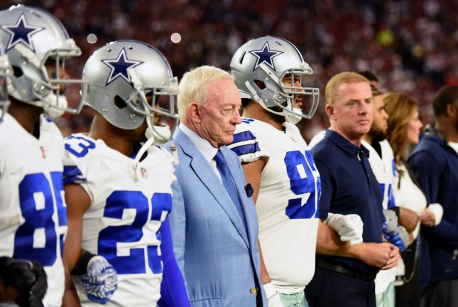 Dallas Cowboys owner Jerry Jones (blue jacket) stands with his players before the national anthem before the Cowboys played the Arizona Cardinals on September 25 at University of Phoenix Stadium in Glendale, Ariz. File photo by Art Foxall/UPI