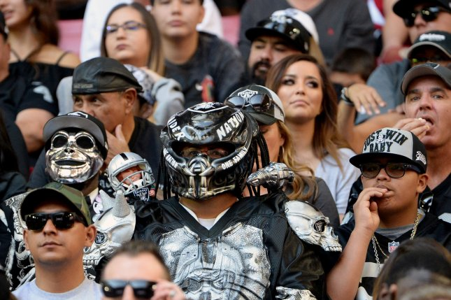 Oakland Raiders fans infiltrate the crowd at the Raiders-Arizona Cardinals game on November 18, 2018 at State Farm Stadium in Glendale, Arizona. Photo by Art Foxall/UPI