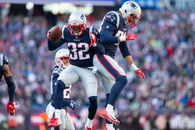 New England Patriots defensive back Devin McCourty (32) and defensive end John Simon (55) celebrate a fumble recovery by McCourty in the second quarter against the New York Jets on Sunday at Gillette Stadium in Foxborough, Massachusetts. Photo by Matthew Healey/UPI