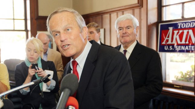 Rep. Todd Akin speaks during a press conference while former Speaker of the House Newt Gingrich looks on at the Kirkwood train station in Kirkwood, Missouri on September 24, 2012. Gingrich is visiting the area to help Akin with his U.S. Senate campaign fundraising where he is opposing incumbant Claire McCaskill. Akin has lost republican party funding after making remarks about rape on a St. Louis television station last month. UPI/Bill Greenblatt
