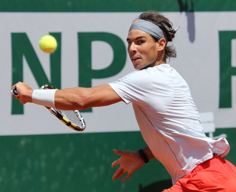 Spaniard Rafael Nadal hits a shot during his French Open men's semifinal match against Serbian Novak Djokovic at Roland Garros in Paris on June 7, 2013. Nadal defeated Djokovic 6-4, 3-6, 6-1, 6-7 (3), 9-7. UPI/David Silpa