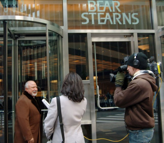 A Bear Stearns employee stops to speak to the media gathered outside the main office building of Bear Stearns in New York following JP Morgan Chase buyout of the stricken investment bank Bear Stearns on March 17, 2008. (UPI Photo/Ezio Petersen)