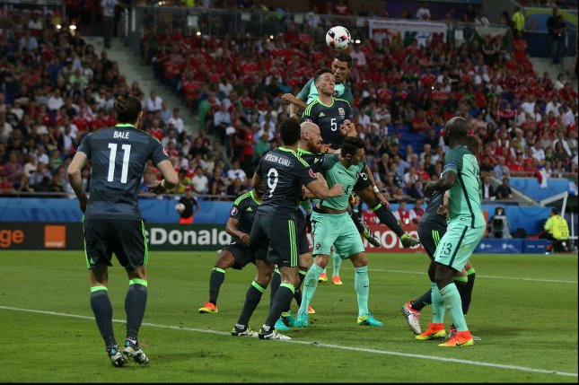 Cristiano Ronaldo of Portugal scores the opening goal during the Euro 2016 Semi-Final match at the Stade de Lyon in Lyon, France on July 6, 2016. Photo by Chris Brunskill/UPI