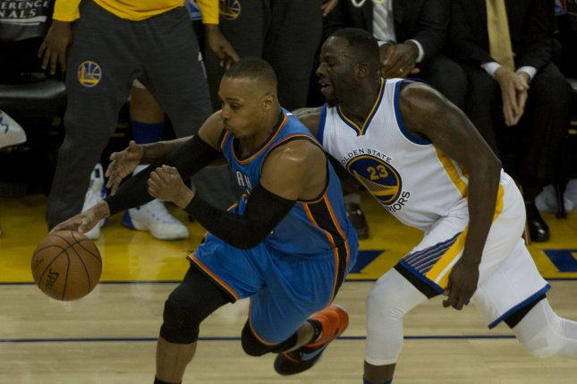 Golden State Warriors' Draymond Green (23) reaches around Oklahoma City Thunder's Randy Foye in the third period of game 5 of the NBA Western Conference Finals at Oracle Arena in Oakland, California on May 26, 2016. The Warriors defeated the Thunder 120-111. Photo by Terry Schmitt/UPI