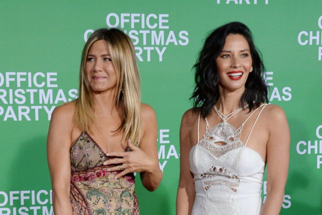 Jennifer Aniston and Olivia Munn attend the Office Christmas Party premiere at the Regency Village Theater in Los Angeles on Wednesday. Photo by Jim Ruymen/UPI