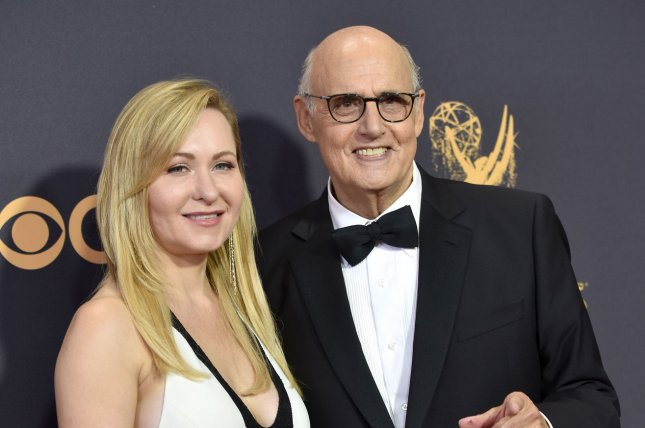 Kasia Ostlun (L) and actor Jeffrey Tambor arrive for the 69th annual Primetime Emmy Awards in Los Angeles on September 17. Tambor is out as star of the Amazon series Transparent. File Photo by Christine Chew/UPI