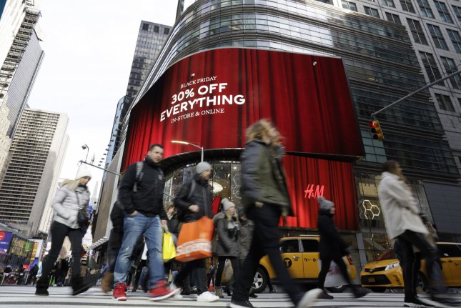 Shoppers walk in New York City's Times Square on Black Friday, November 29. Photo by John Angelillo/UPI