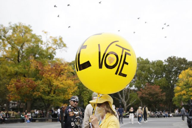 Vote is written on a yellow balloon as People gather at the Plus1Vote's March for National Early Vote Day rally on the first day of early voting for the 2020 election in New York City on Saturday, October 24, 2020. New York City voters for the first time have the option for early voting for the 2020 election and some waited online hours before their polling site opened at 10 a.m. Photo by John Angelillo/UPI