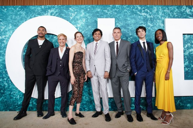 Left to right, Aaron Pierre, Gael Garcia Bernal, Vicky Krieps, M. Night Shyamalan, Rufus Sewell, Alex Wolff and Nikki Amuka-Bird arrive on the red carpet at the Old New York premiere on July 19. Photo by John Angelillo/UPI