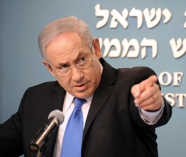 Israeli Prime Minister Benjamin Netanyahu gestures while summing up his first year in office at a press conference in his office in Jerusalem, April 7, 2010. UPI/Debbie Hill