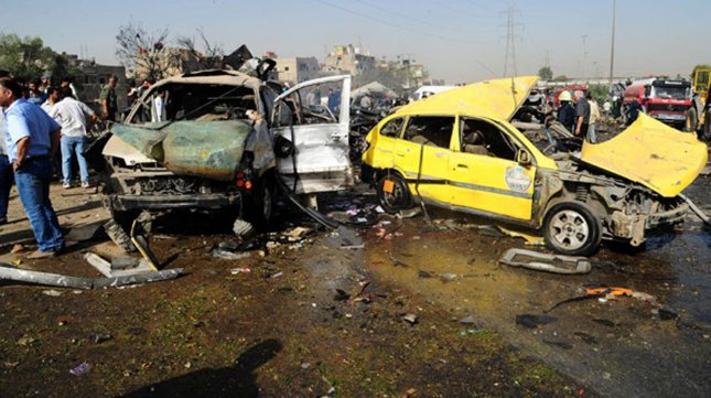 A handout picture released by the Syrian Arab News Agency (SANA) shows burning vehicles at the site of twin suicide bomber blasts in Damascus on May 10, 2012. Americans in Lebanon are worried that hostilities in Syria will cross the border. UPI