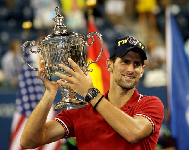 Novak Djokovic shown with his 2011 U.S. Open championship trophy, was injured Sunday during a Davis Cup match. That turned out to the the decisive point and Argentina advanced to the Davis Cup finals over Djokovic's Serbian team. Serbia was the defending Davis Cup champion. UPI/Monika Graff