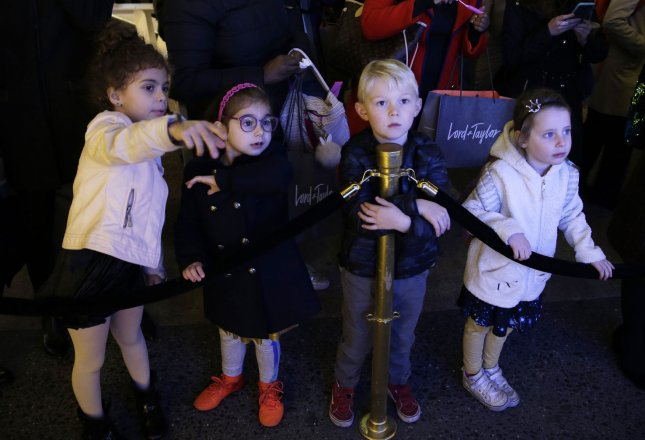 Children look at the 2017 Lord & Taylor Holiday Window unveiling at Lord & Taylor on November 9 in New York City. A new study says the birth rate is falling in the United States, which could help the economy. Photo by John Angelillo/UPI