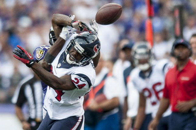 Houston Texans cornerback Johnathan Joseph battles for a pass during a game against the Baltimore Ravens in 2013. File photo by Pete Marovich/UPI