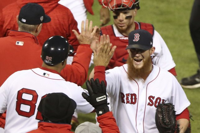 Boston Red Sox reliever Craig Kimbrel (R) high fives teammates after retiring the Los Angeles Dodgers in Game 2 of the 2018 World Series at Fenway Park in Boston, Mass., Wednesday night. The Red Sox hold a 2-0 series lead after beating the Dodgers 4-2. Photo by Matthew Healey/UPI