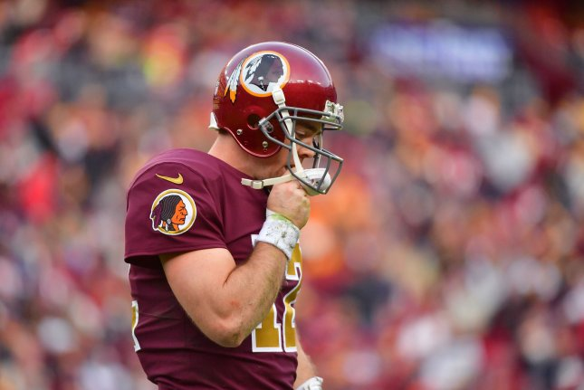 Washington Redskins quarterback Colt McCoy (12) leaves the field in the closing moments of the game as the Texans defeated the Washington Redskins 23-21 at FedEx Field in Landover, Maryland on November 18, 2018. Photo by Kevin Dietsch/UPI