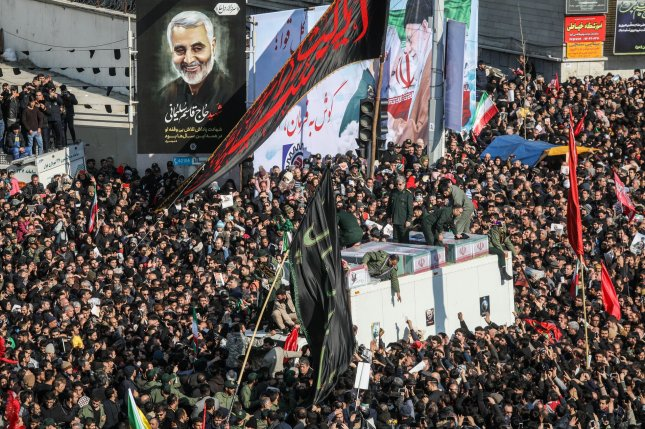 Thousands of Iranian mourners gathered around the coffins of Iranian Revolutionary Guards Commander Qasem Soleimani to pay tribute to their fallen leader during his funeral in Tehran, Iran, on Monday. Photo by Majid Asgaripour/UPI