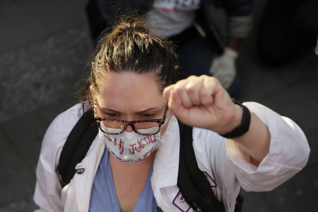 Healthcare workers in the United States and Britain faced significant challenges during the early stages of the COVID-19 pandemic, a new study has found. Photo by John Angelillo/UPI