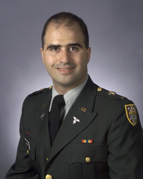 Maj. Nidal Malik Hasan, is shown in a 2003 file photo from the Uniformed Services University of the Health Sciences. Hasan may be paralyzed from the waist down according to a statement by his attorney Nov. 13, 2009. Hasan has been charged with 13 counts of premeditated murder stemming from the killings at Fort Hood. UPI