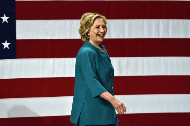 Presidential candidate and Former Secretary of State Hillary Clinton walks on the stage before delivering a speech at Florida International University in Miami, Fla., July 31, 2015. Friday, she also released her tax returns for 2007-2014 -- during which she paid nearly $44 million to the IRS -- and a physician's letter outlining her clean bill of health. Photo: Gary I. Rothstein/UPI