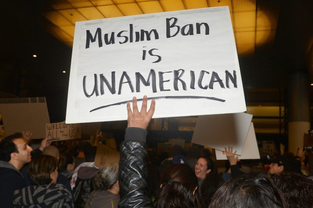 Hundreds of people who oppose President Donald Trump's executive order temporarily halting immigration from certain Muslim-majority nations protest at Los Angeles International Airport on Saturday. Photo by Jim Ruymen/UPI