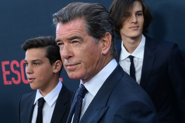 Cast member Pierce Brosnan (C) and his sons Paris Brosnan (L) and Dylan Brosnan attend the premiere of the motion picture thriller No Escape in Los Angeles on August 17, 2015. Brosnan's AMC series The Son has been renewed for a second season. File Photo by Jim Ruymen/UPI