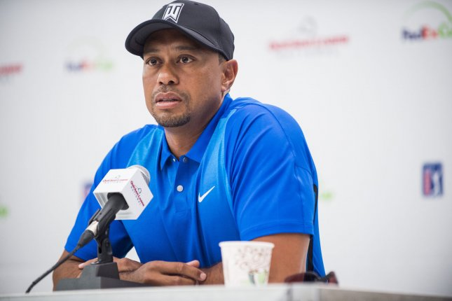 Professional golfer and tournament host, Tiger Woods, answers questions about his event and his health from the media during a press conference at the Quicken Loans National golf tournament. File photo by Pete Marovich/UPI