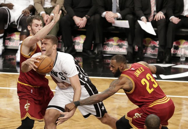 Cleveland Cavaliers Kevin Love and LeBron James defend Brooklyn Nets Brook Lopez in the second quarter at Barclays Center in New York City on January 6, 2017. The Cavaliers defeated the Nets 116-108. Photo by John Angelillo/UPI