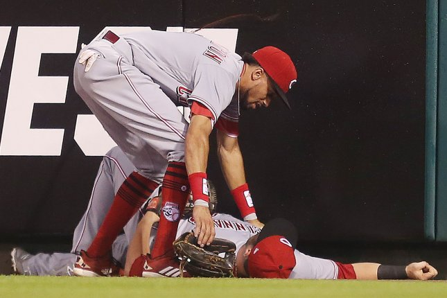 Cincinnati Reds' Billy Hamilton checks on right fielder Scott Schebler after he crashed into the wall making a catch on a ball hit by St. Louis Cardinals catcher Yadier Molina in the sixth inning on July 14 at Busch Stadium in St. Louis. Photo by Bill Greenblatt/UPI