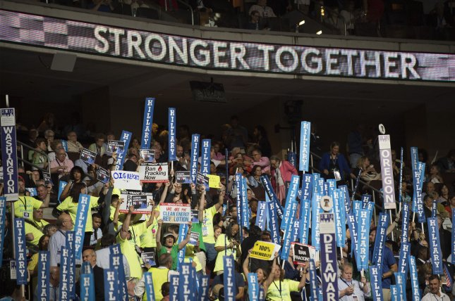 Delegates raise Hillary signs during day four of the Democratic National Convention in 2016. On Saturday, the DNC approved an overhaul to party rules that reduces the power of superdelegates by limiting their ability to vote on the first ballot for the party's presidential nominee. Photo by Pete Marovich/UPI