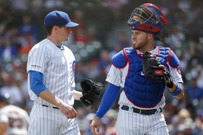 Chicago Cubs starting pitcher Kyle Hendricks (L) lowered his 2019 ERA to 3.20 after allowing just three hits in seven scoreless innings against the San Francisco Giants Thursday in Chicago. Photo by Kamil Krzaczynski/UPI