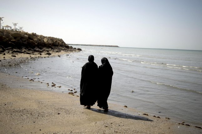 Iranian women walk on the shore of the Oman Sea in Chabahar, a city in southeastern Iran near the Strait of Hormuz, on January 16, 2012. Chabahar is a free trade zone on the coast of the Gulf of Oman. India is helping Iran to develop the Chabahar port, which is Iran's closest and best access point to the Indian Ocean. UPI/Maryam Rahmanian