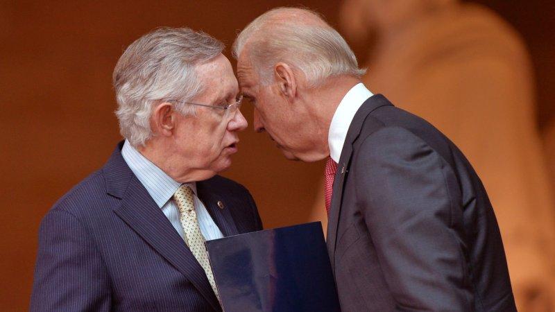 Senate Majority Leader Harry Reid talks to Vice President Joe Biden. UPI/Kevin Dietsch