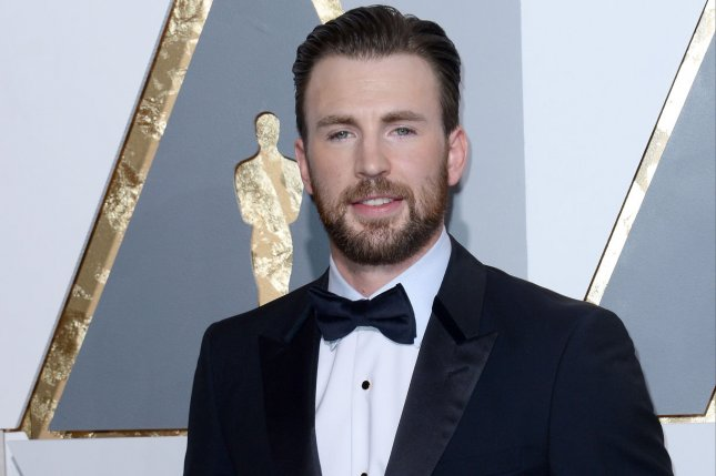 Actor Chris Evans arrives on the red carpet for the 88th Academy Awards on February 28. Captain America: Civil War co-director Joe Russo recently described the upcoming superhero epic as a love story. File Photo by Jim Ruymen/UPI