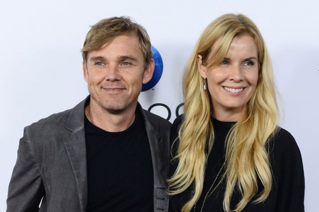 Ricky Schroder (L) and Andrea Schroder at the Los Angeles premiere of Machete Kills on October 2, 2013. File Photo by Jim Ruymen/UPI