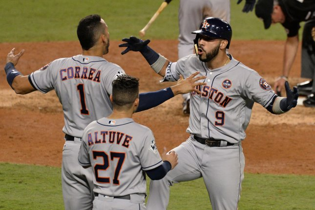 Houston Astros Marwin Gonzalez (9) celebrates his solo home run against the Los Angeles Dodgers Wednesday night with teammates Carlos Correa and Jose Altuve in the eighth inning of the 2017 MLB World Series at Dodger Stadium in Los Angeles, Calif. The series is tied 1-1. Photo by Jim Ruymen/UPI