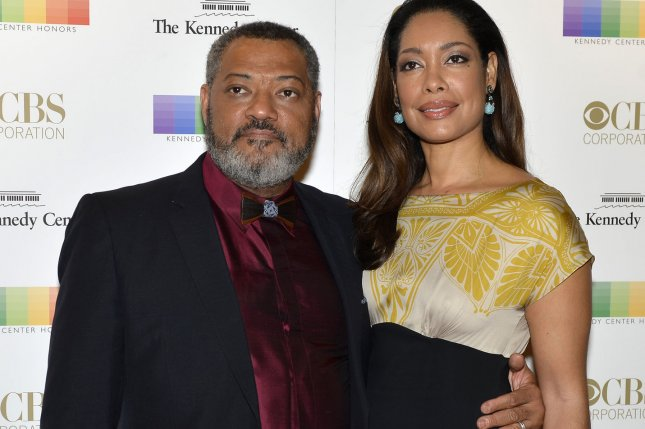 Actor Lawrence Fishburne and his wife actress Gina Torres on December 6, 2015, in Washington, D.C. Torres is to star in a new Suits spinoff for USA Network. File Photo by Mike Theiler/UPI