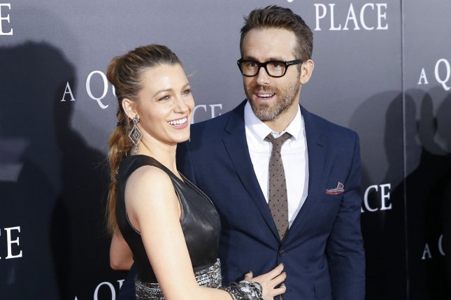 Ryan Reynolds (R) and Blake Lively are parents to 4-year-old James and 2-year-old Ines. File Photo by John Angelillo/UPI