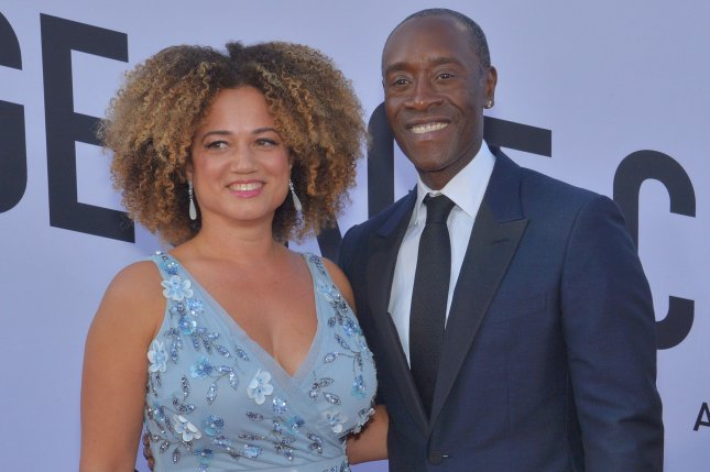 Don Cheadle (R) and his longtime partner Bridgid Coulter. Cheadle said on The Tonight Show that he and the Avengers cast plays Boggle together. File Photo by Jim Ruymen/UPI