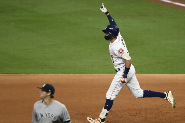 Houston Astros slugger Carlos Correa celebrates after hitting a walk-off solo home run to beat the New York Yankees in Game 2 of the American League Championship Series on Sunday at Minute Maid Park in Houston. Photo by Trask Smith/UPI