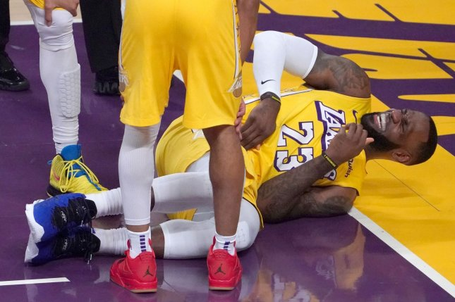 Los Angeles Lakers forward LeBron James grimaces in pain during the first quarter against the Los Angeles Clippers on Wednesday at Staples Center in Los Angeles. Photo by Jon SooHoo/UPI