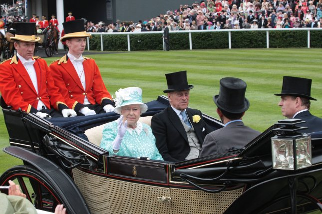 Queen Elizabeth II and her husband, the Duke of Edinburgh, Prince Philip, arrive at the Royal Ascot near Windsor in June 2009. The royals will not be attending this year because of the pandemic. File Photo by Hugo Philpott/UPI