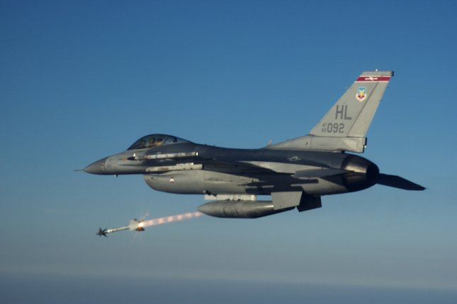 Captain Steve Boatright, an F-16C Fighting Falcon pilot with the 34th Fighter Squadron Rude Rams, located at Hill Air Force Base, Utah, fires an AIM-9M Sidewinder heat-seeking missile at an MQM-107 Streaker sub-scale aerial target drone over the Gulf of Mexico recently. Photo by Michael Ammons/U.S. Air Force