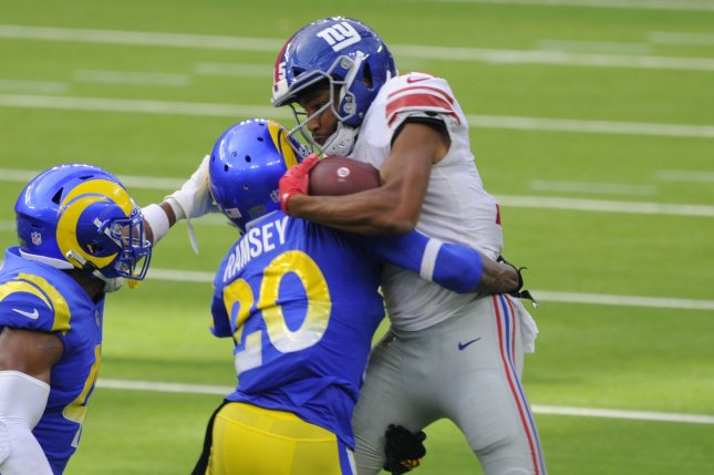 Los Angeles Rams cornerback Jalen Ramsey (20) tackles New York Giants wide receiver Golden Tate in the second half of Sunday's game at SoFi Stadium in Inglewood, Calif. Photo by Lori Shepler/UPI