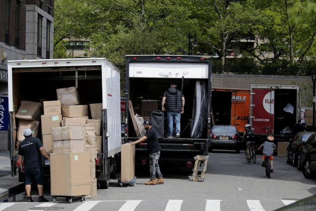 Moving trucks, workers and boxes dominate a street in New York City on May 27, 2020,shortly after Gov. Andrew Cuomo ordered that renters cannot be thrown out for nonpayment due to hardship from the coronavirus crisis. File Photo by John Angelillo/UPI