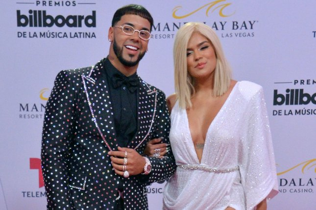 Karol G (R) and Anuel AA have ended their engagement after more than two years of dating. File Photo by Jim Ruymen/UPI